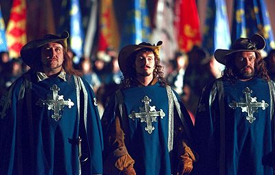 Athos (right) and Porthos (left) with Aramis.